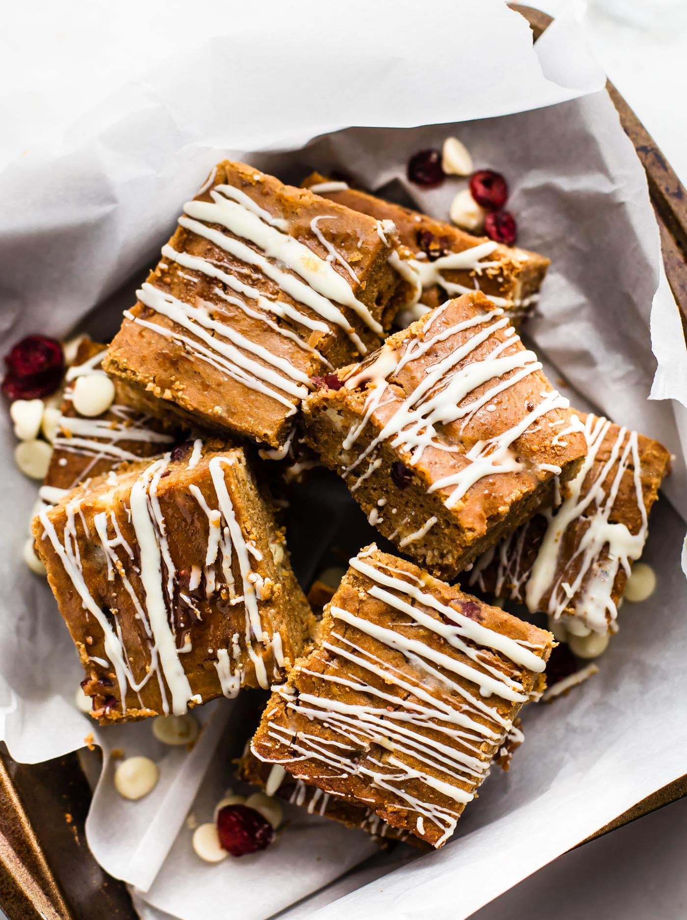 Cranberry White Chocolate Pumpkin Bars made Healthier and Gluten free! Easy to make, eggless, and delicious. Vegan friendly.