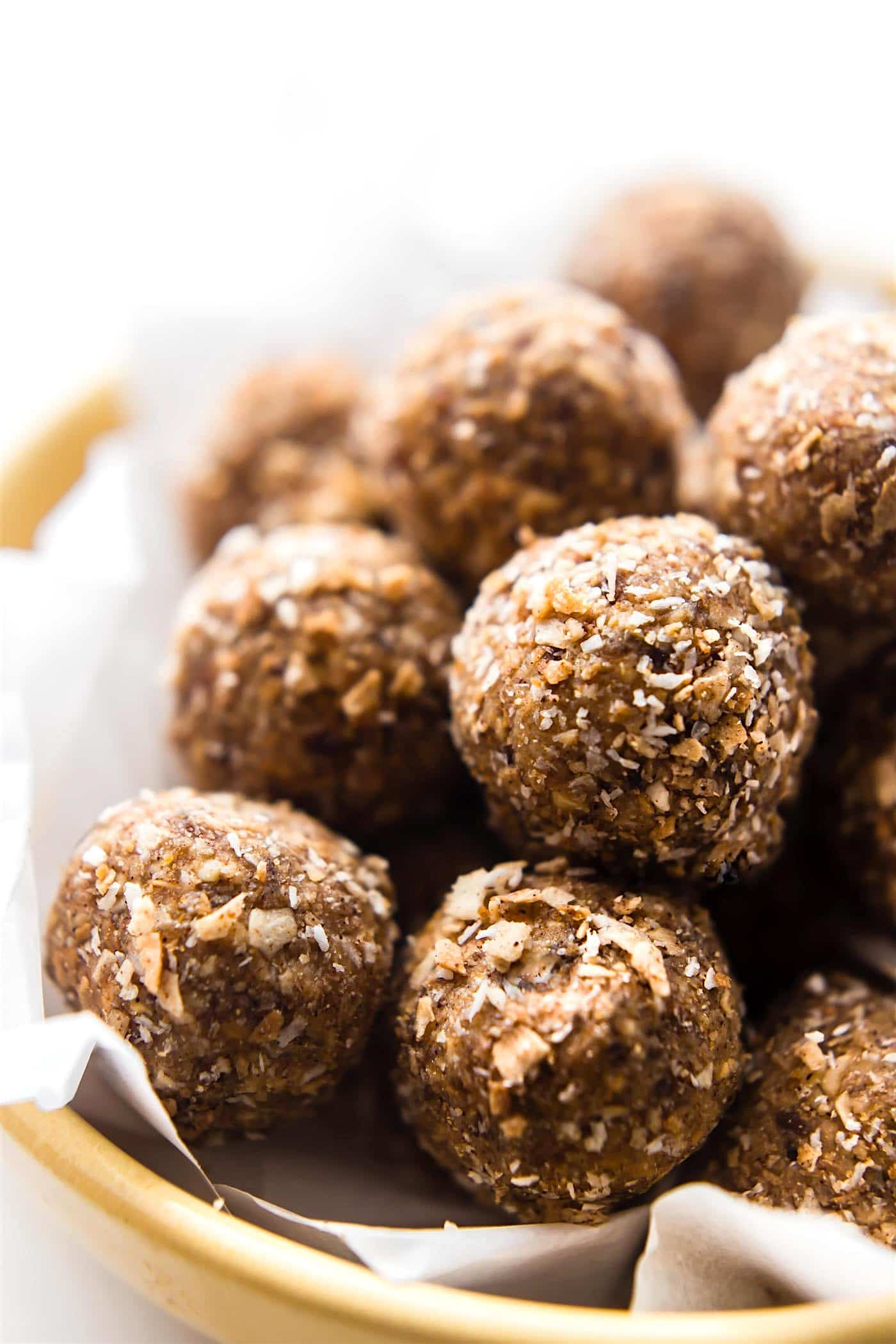 Toasted Coconut Bliss balls ya'll! A sweet and salty snack ball! Oh my! Paleo and Vegan friendly, crunchy, chewy, the perfect treat! Make for yourself or even for holiday festivities! Get the BLISSFUL recipe --> www.cottercrunch.com