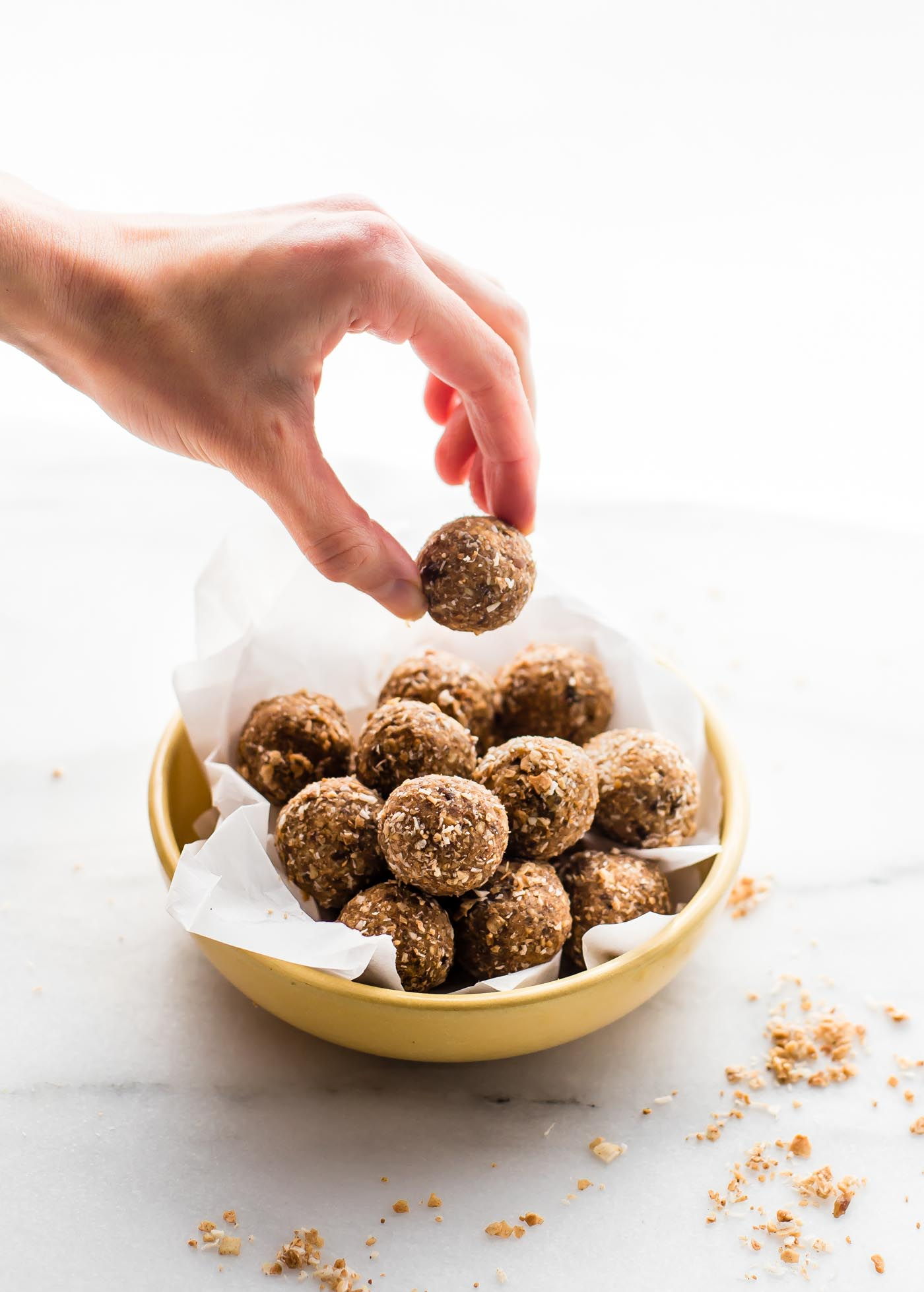 Cinnamon Toasted Coconut Bliss balls. A healthy sweet bliss balls recipe made with dates, cashews, toasted coconut, and maple. An easy Paleo & vegan snack or treat.