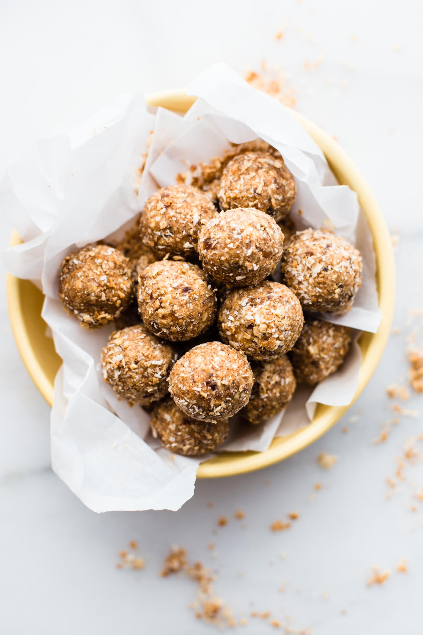 Toasted Coconut Bliss balls ya'll! A sweet and salty snack ball! Oh my! Paleo and Vegan friendly, crunchy, chewy, the perfect treat! Make for yourself or even for holiday festivities! Get the BLISSFUL recipe www.cottercrunch.com