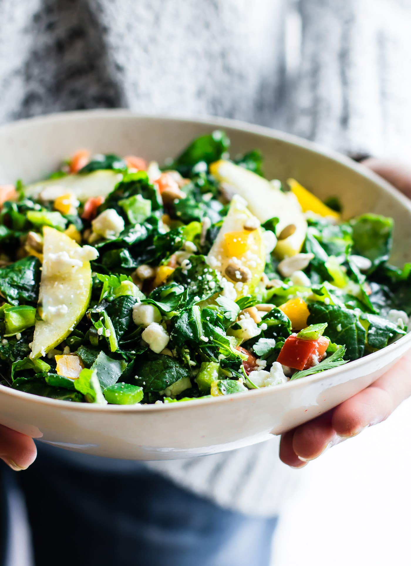 A satisfying ZIPPY kale salad packed with delicious ingredients and a light honey dressing. Crisp pear, seasonal kale, goat cheese, and more! Just like your favorite restaurant style salad, but easy to make make fresh at home all in one bowl. Just toss and go! Great as a healthy vegetarian main or a side salad for any dish!