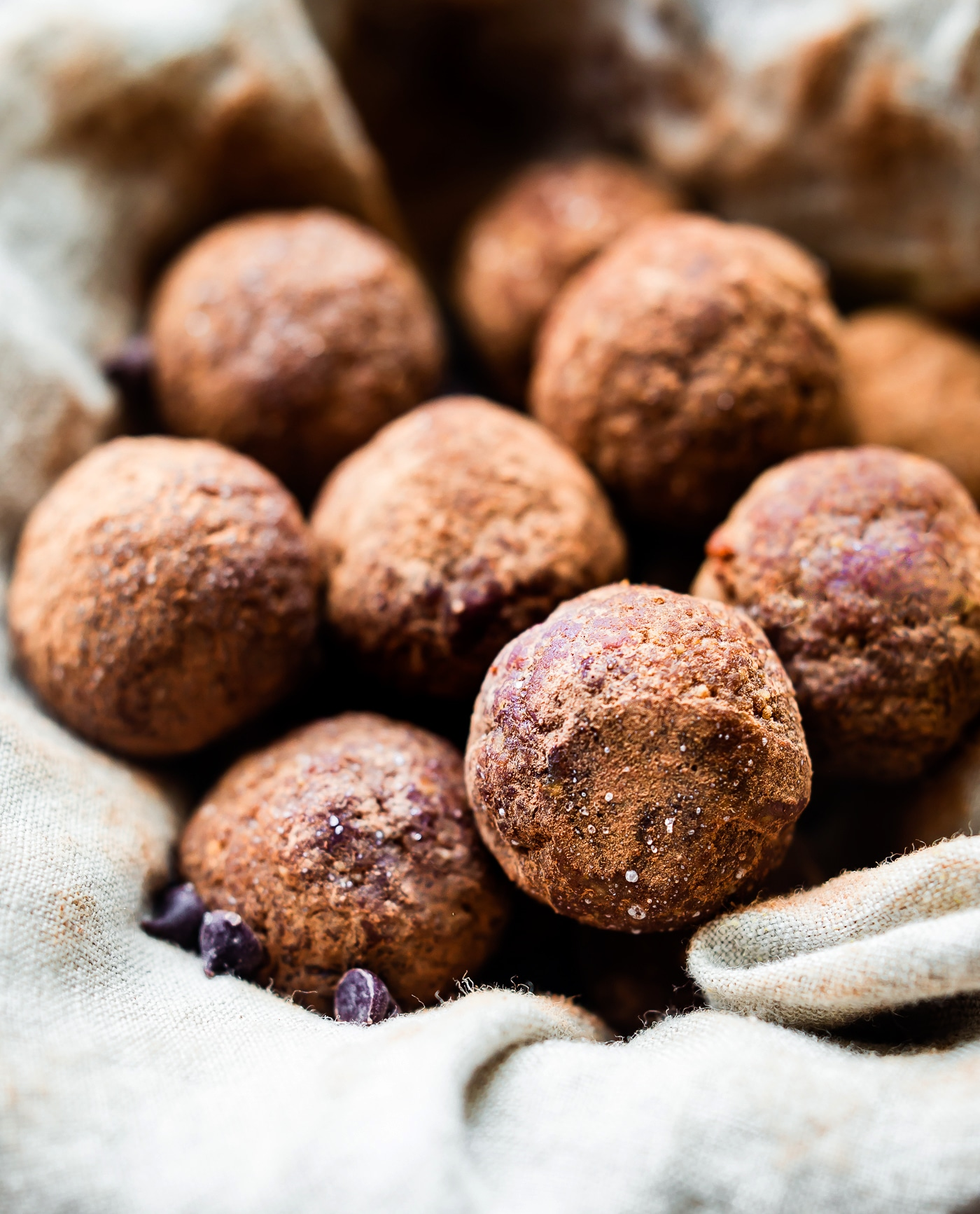 Chocolate Chewy Energy Bites made right in your blender! These dark chocolate energy bites are easy to make, sweet, chewy, and absolutely delicious! Paleo, Vegan, and Whole 30 friendly! An energizing chewy snack that perfect for anytime of day!