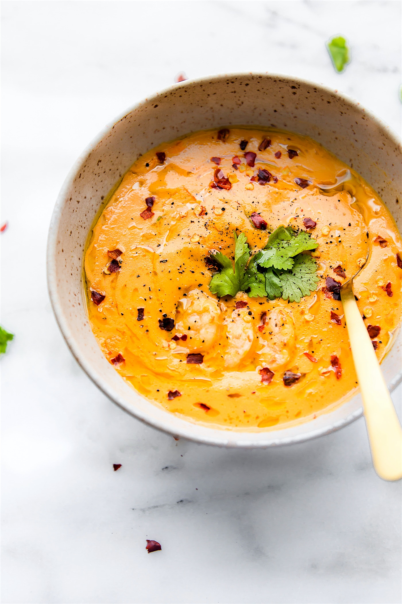 This creamy roasted red pepper bisque with Shrimp is dairy free, paleo, and totally delicious! A spicy bisque with healing immunity boosting nutrients. Perfect for cold weather or under the weather! Also a great way to get veggies into your meal. Nourish your family, feed your friends, or enjoy this robust roasted red pepper bisque recipe all to yourself. Whole 30 compliant. !