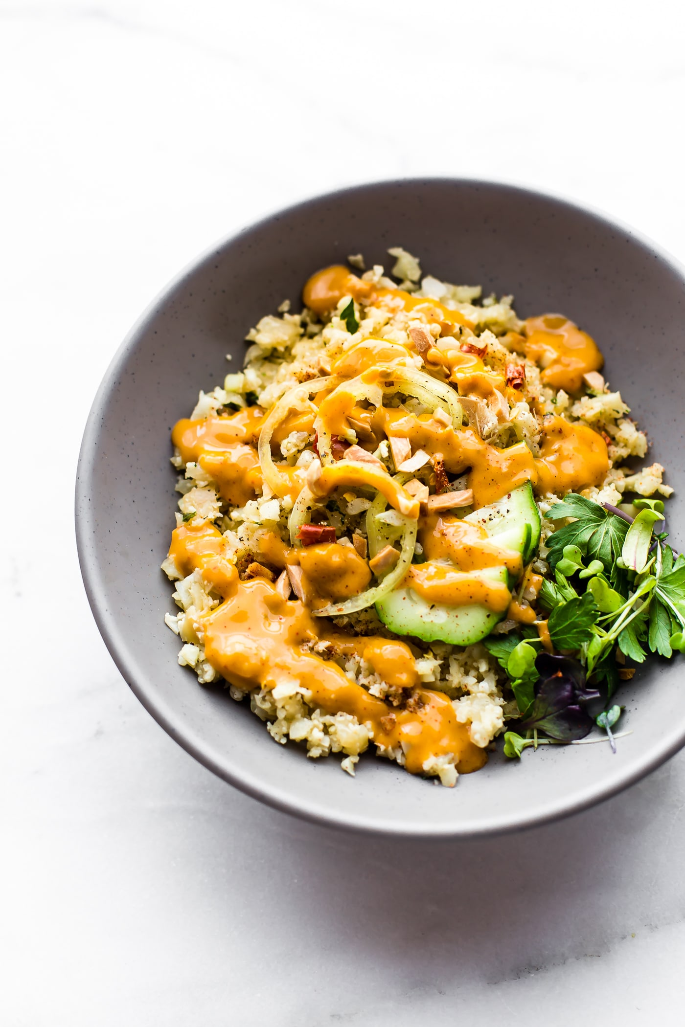 "Chili Garlic Cauliflower ""Risotto"" Bowls are a quick Paleo dish for a healthy comfort food craving! A vegan vegetable risotto recipe with a spicy sauce!"