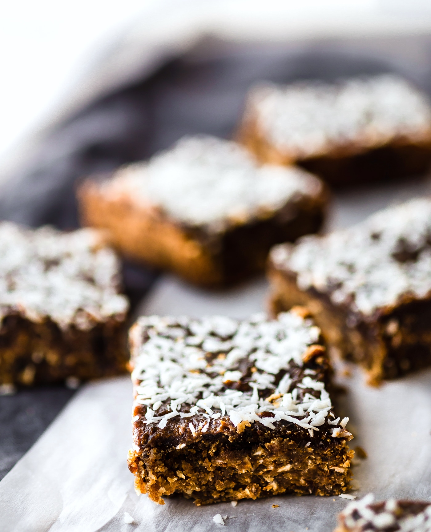 These Paleo Almond Butter Jelly Energy Bars are one of our favorite bars that fuel us for workouts and snacking on the go. Made with few ingredients; no oils and no refined sugar. Blended and Baked in just 30 minutes, Which makes them pretty amazing! So chewy and flavorful that you'd never know they were healthy. Freezer friendly.