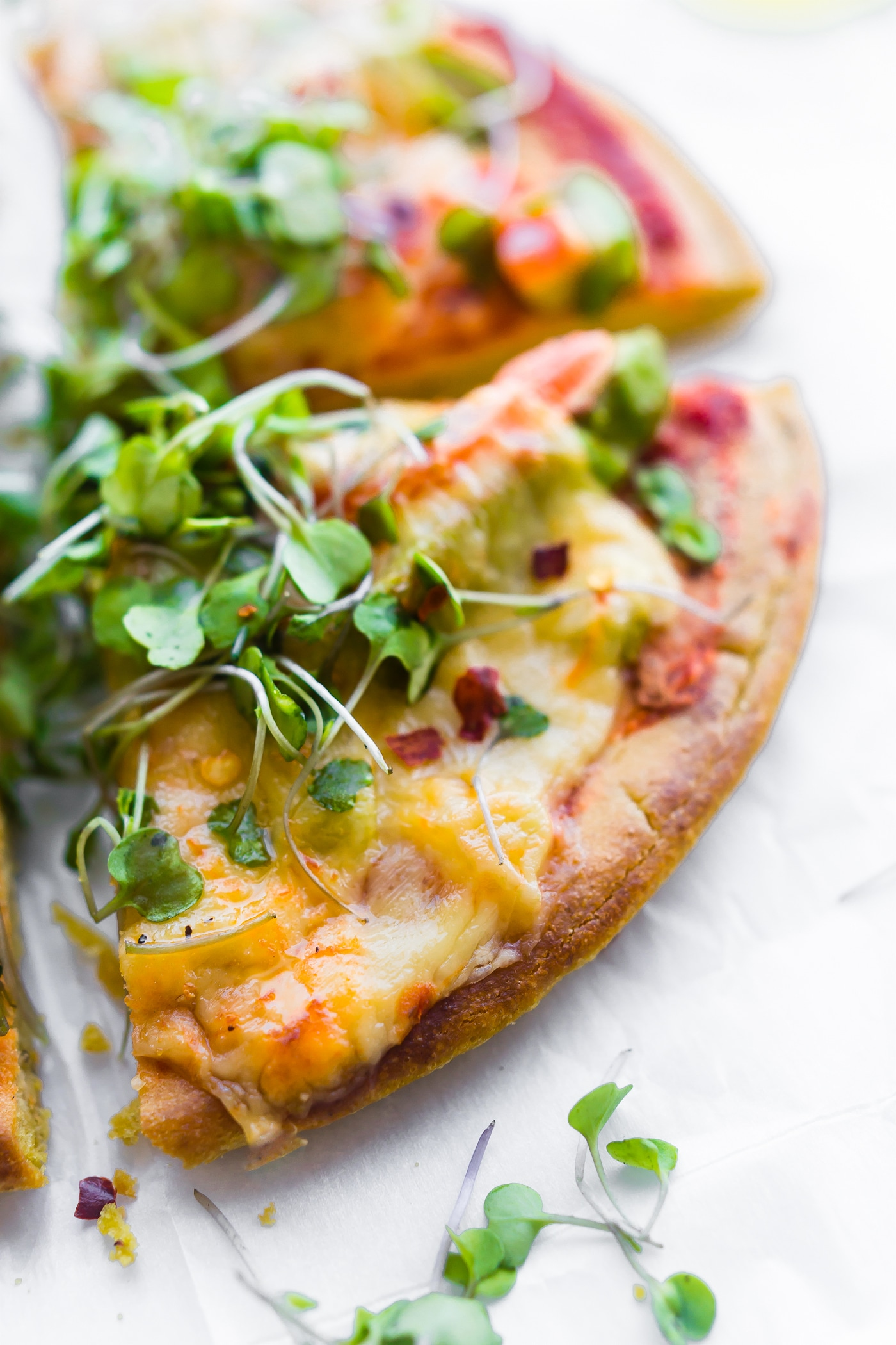 Avocado Tomato Gouda Socca Pizza recipe to love! Agrain free, gluten free Avocado Tomato Gouda Socca Pizza made withchickpea flour and topped with Avocado, Gouda, Tomato, and Greens! Seriously easy to make, egg free, vegan option, OMG delicious!