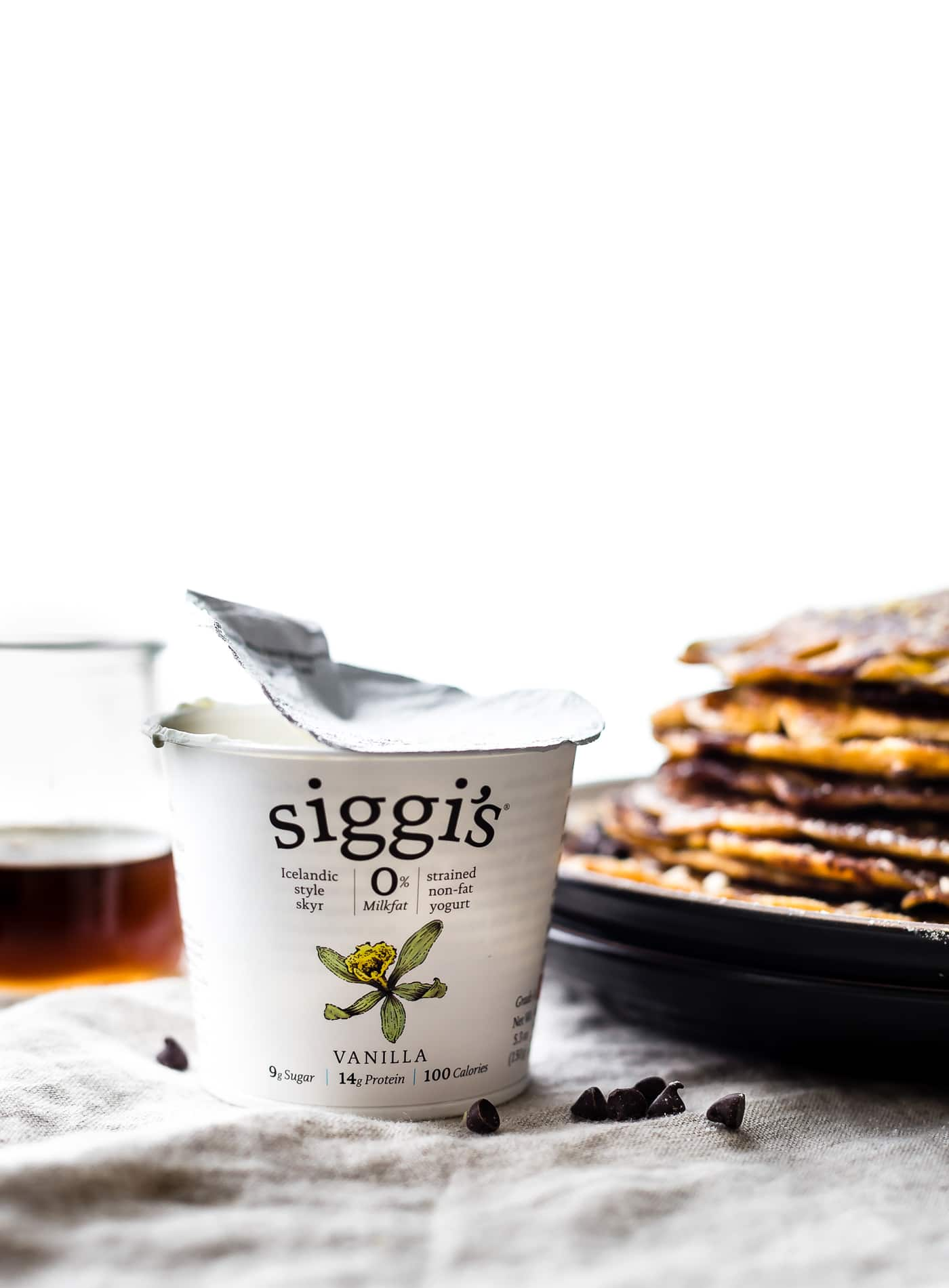 """A Flourless Carrot Cake Yogurt Pancakes recipe that's perfect for breakfast or brunch. These Flourless Carrot """"Cake"""" Yogurt Pancakes are too good to be true! Made with siggi's vanilla yogurt, making them lower in sugar, gluten free, and protein packed! An easy blender recipe. @siggisdairy #sponsored"""