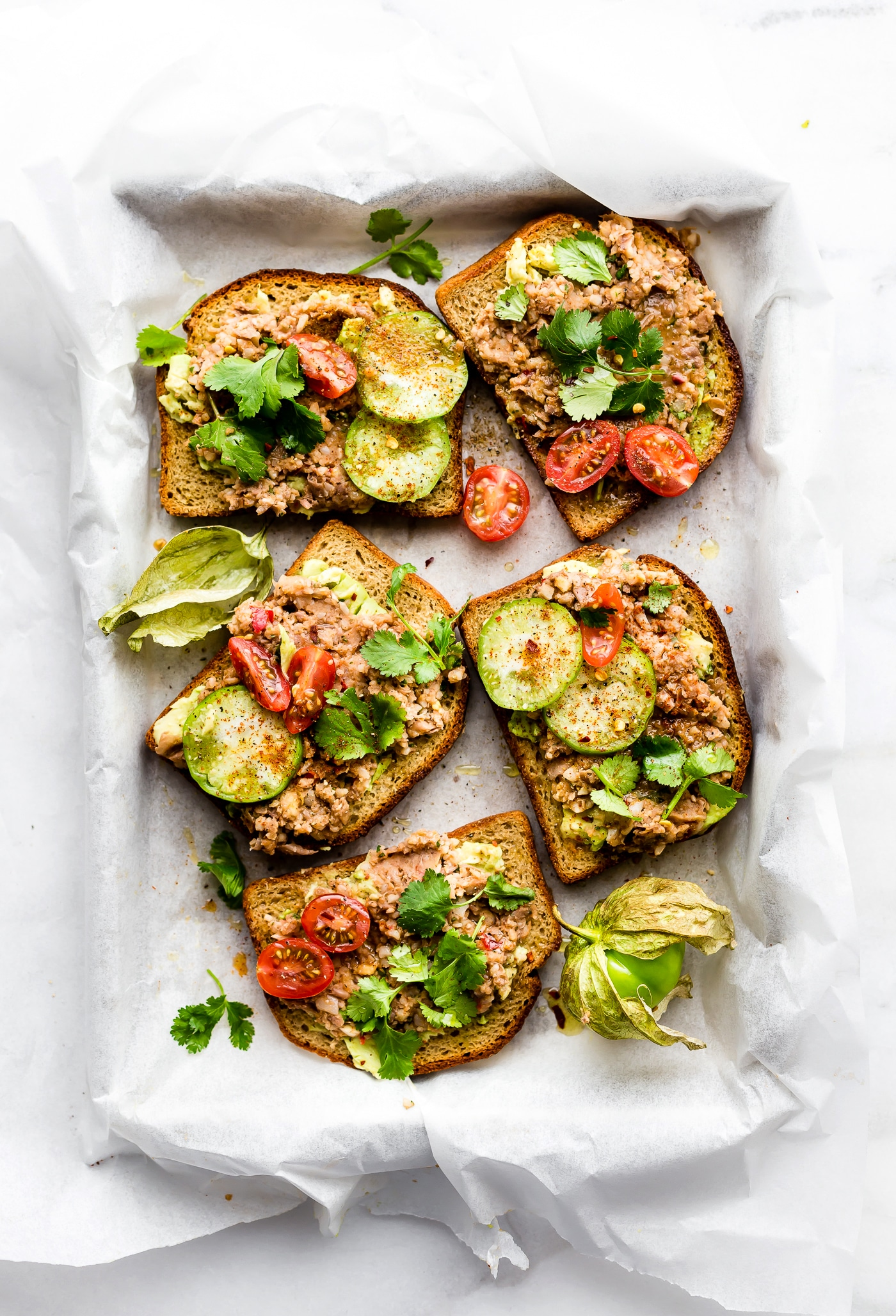 Smashed Mexican Beans Avocado Toast! Avocado Toast Recipes need a little upgrade. This Fully Loaded MEXICAN style avocado toast recipe is Gluten Free, Vegan Friendly loaded with Flavor!! A simple, yet spicy, meatless meal, breakfast, or even a healthy appetizer.