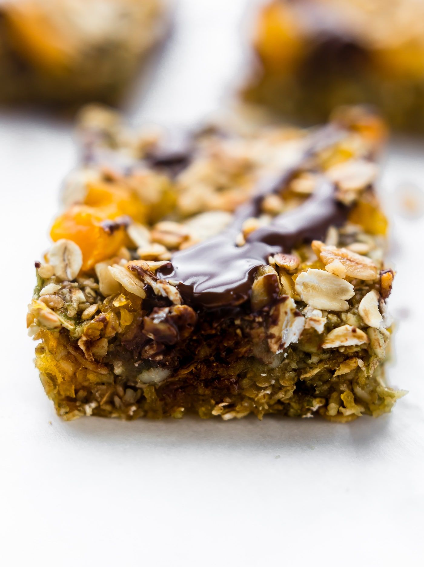 No Bake Apricot Oat Protein Bars easy to make, wholesome, and nut free! Made with dried apricots, gluten free oats, protein, & seeds! Sweet, chewy, vegan!