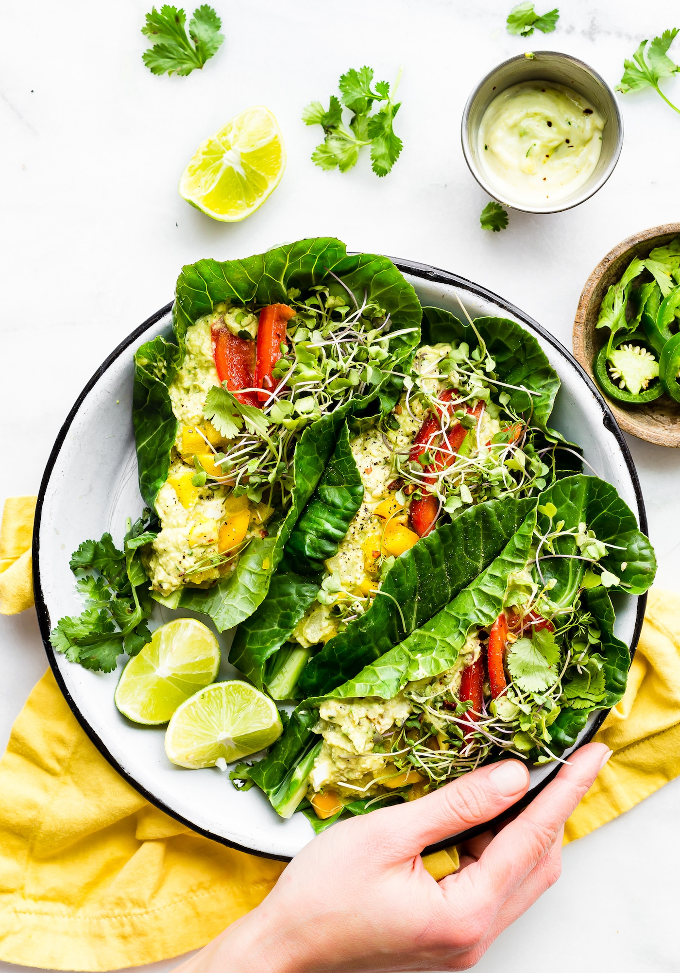 Spice up lunch with these Paleo MEXICAN AVOCADO EGG SALAD COLLARD GREEN WRAPS! A quick veggie packed lunch!