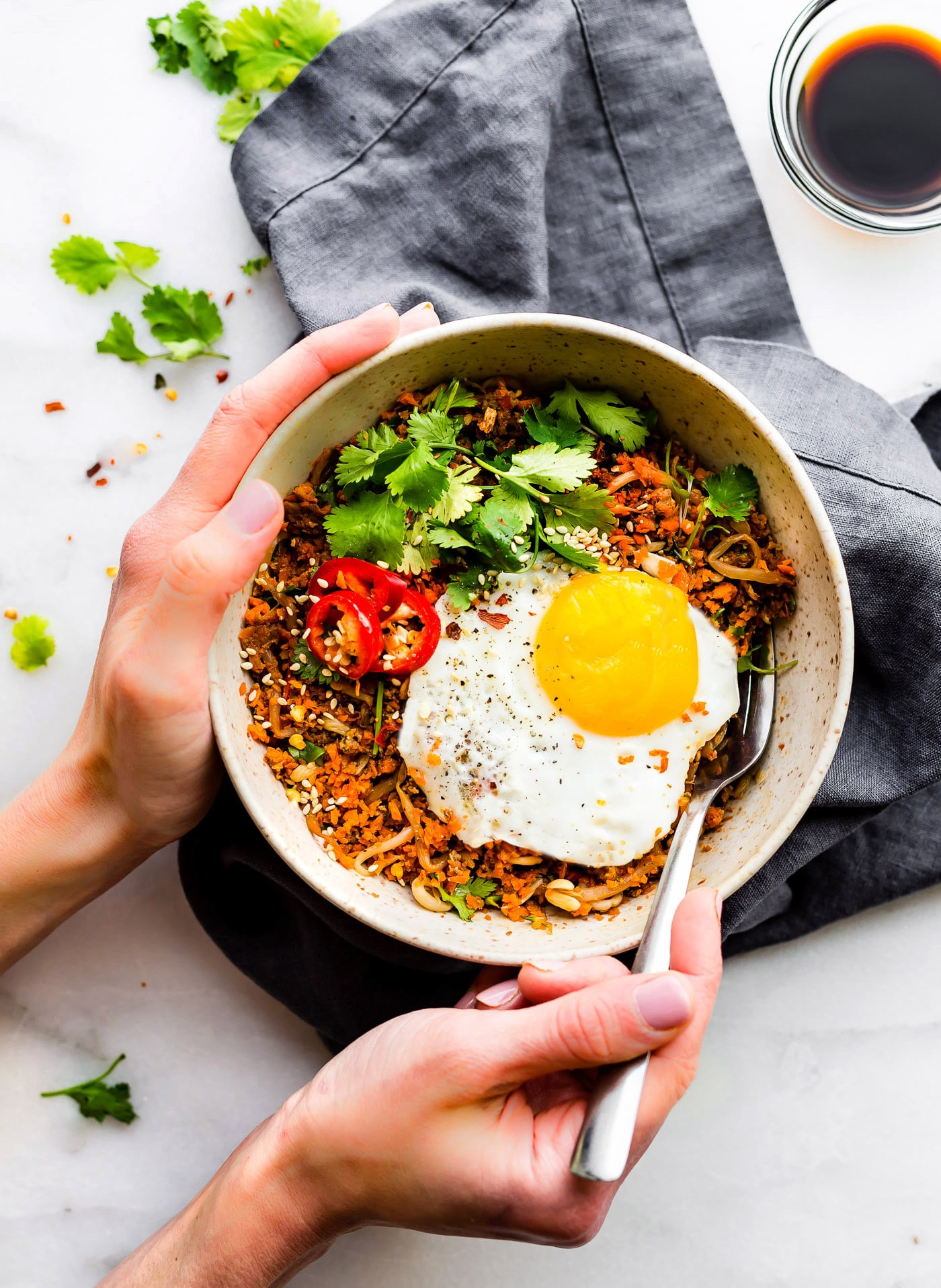 A Indonesian style breakfast Nasi Goreng that's paleo friendly, super flavorful, and packed full of protein and veggies! Cook and serve all in 30 minutes! dairy free- anti inflammatory meal plan!