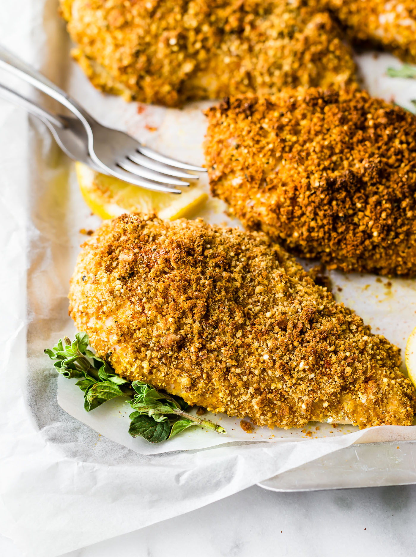 Gluten-free Panko Crusted Paprika Chicken recipe! A baked chicken recipe with gluten-free panko bread crumbs and paprika spices! Easy, quick, one pan meal. Dairy free friendly