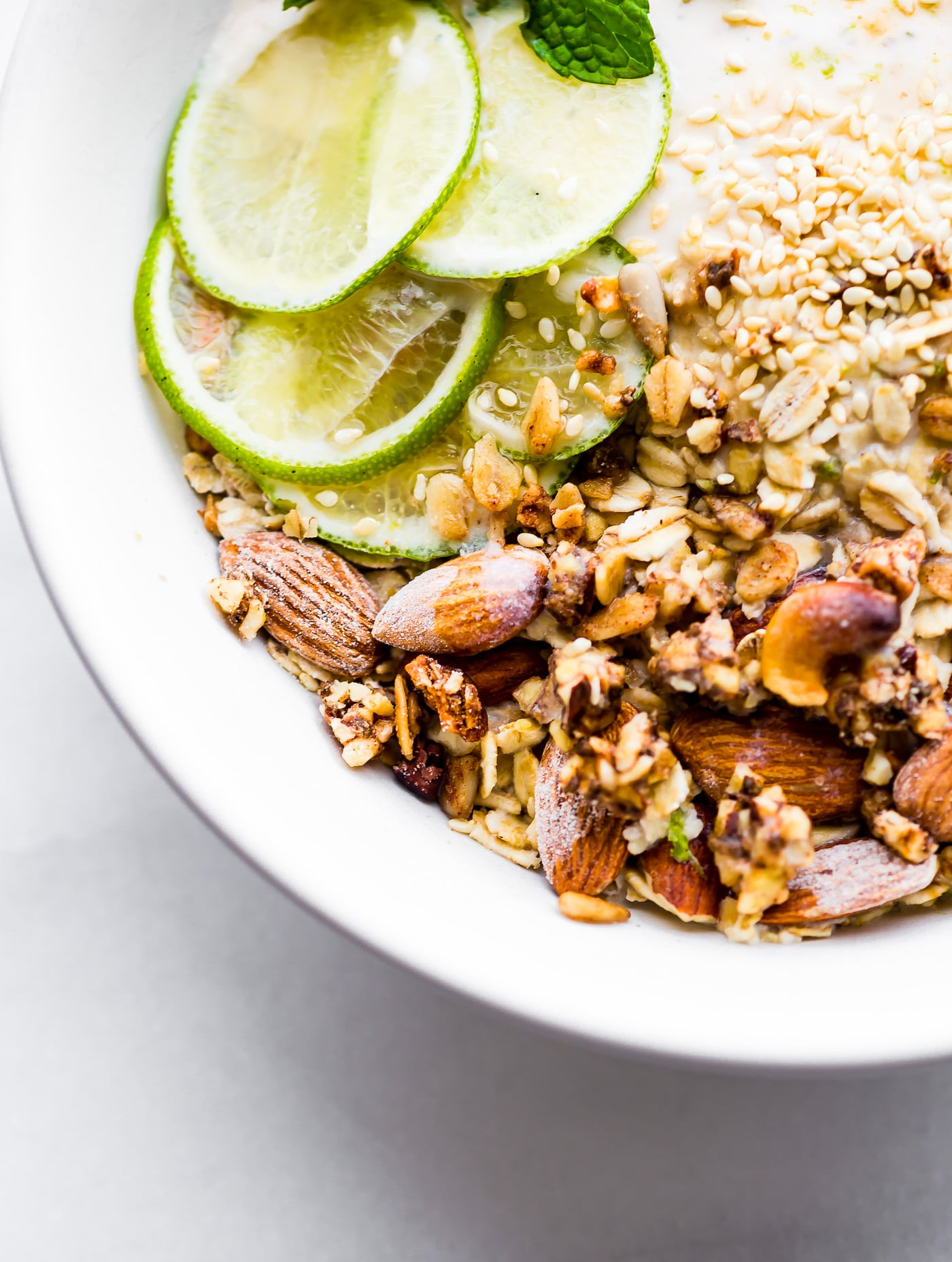 This Zesty Tropical Yogurt Overnight Muesli recipe is the perfect make ahead breakfast bowl! Gluten- free, nutrient rich, and made with Icelandic-style skyr coconut yogurt for a protein boost! www.cottercrunch.com