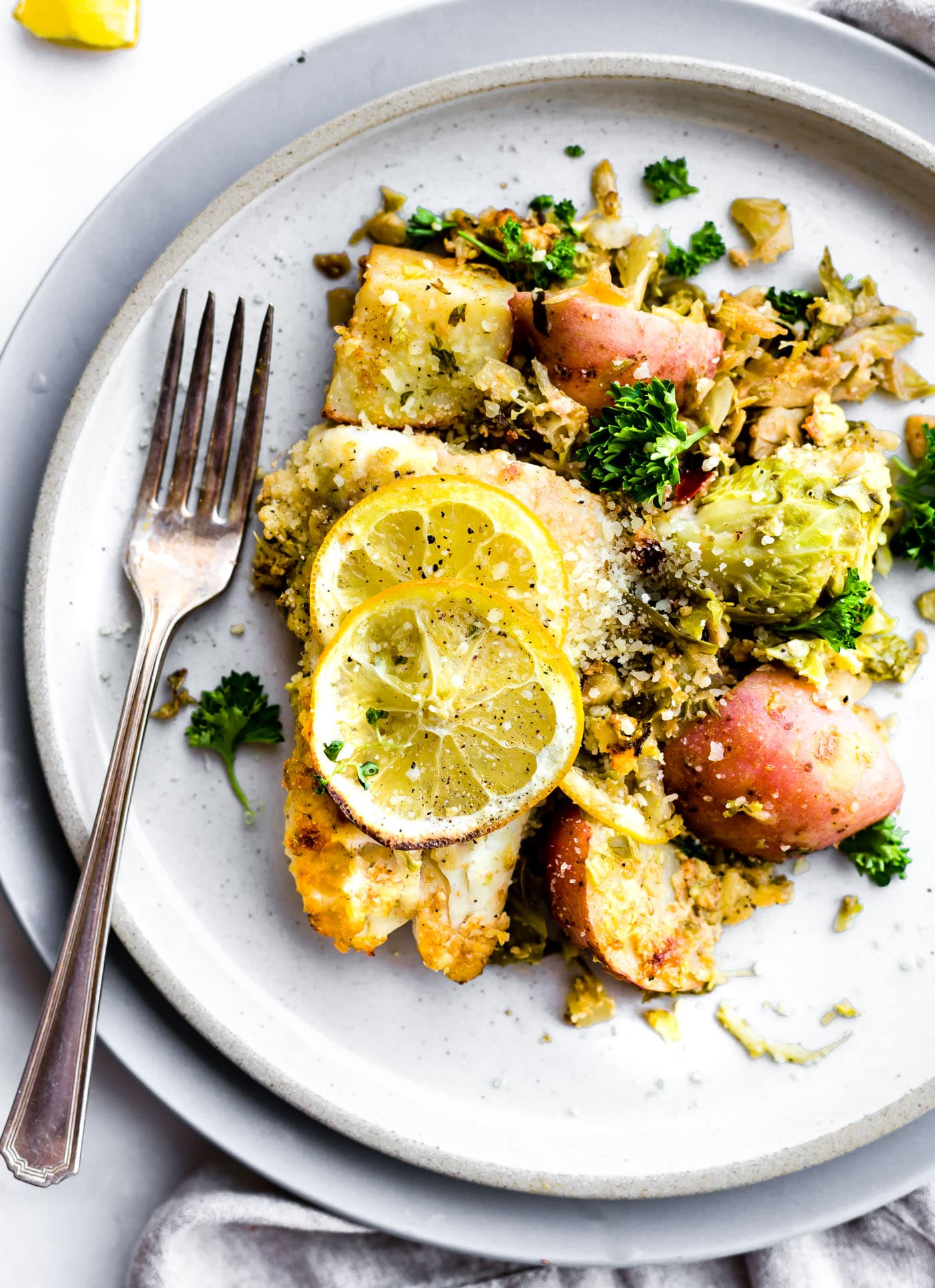 Honey mustard baked fish and vegetable recipe is a quick one pan meal ready in 30 minutes! A complete meal with healthy, lightfish, then baked with wholesome vegetables. Yes, even non fish lovers like it! And all it takes is just a few simple real food ingredients. Promise! Get a healthy dinner on the table in no time ya'll! Paleo friendly.