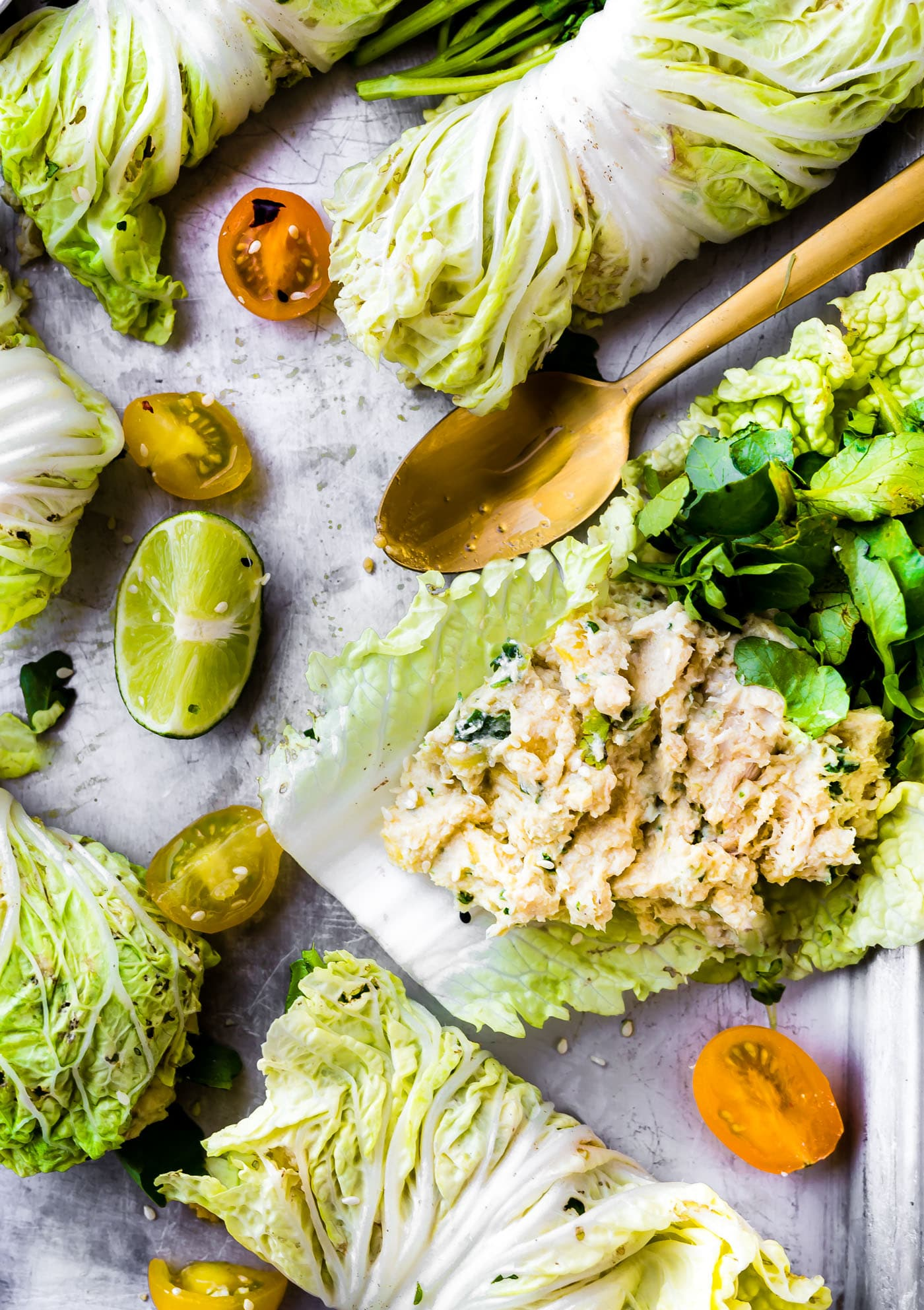 Perfect as a handy lunch or light Miso Mango Chicken Salad Cabbage wraps are the perfect light low carb lunch that's easy to make! A mango chicken salad that's mayo free, paleo friendly, and flavorful! Spread the miso mango chicken salad mixture over napa cabbage, add a little bit of watercress, then firmly roll up! Bam, a perfectly handy lunch or light dinner!