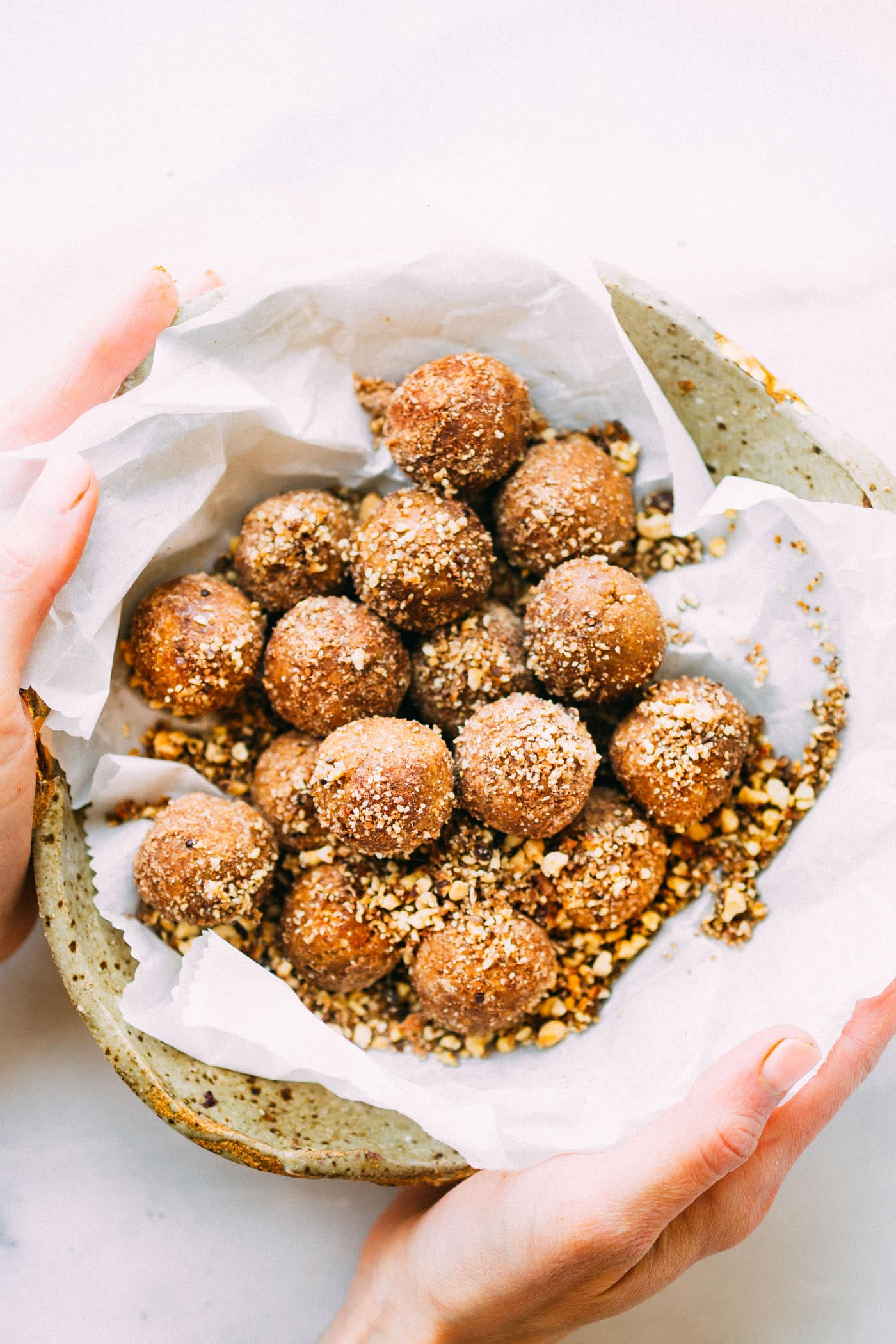 Ultimate No Bake Breakfast Cookie Bites recipe! Packed full wholesome ingredients, rich in fiber, a boost of protein! Tastes like a cookie but suitable for breakfast! Cinnamon, oats, nuts, spices, molasses, and maple syrup. It's heavenly ya'll! And vegan friendly too.