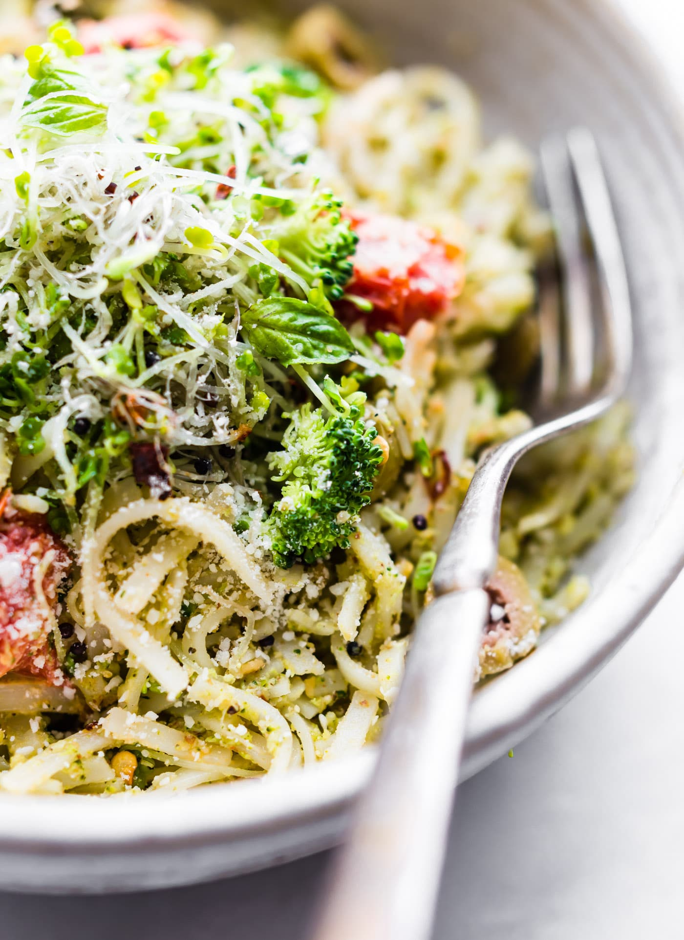 This gluten free Peppery Broccoli Arugula Pesto Pasta is gonna rock your world! A pesto pasta with broccoli and arugula and packed with nutrition and flavor! An easy pasta dinner for a quick weeknight dinner or healthy lunch! Ready in under 30 minutes and vegan friendly option. www.cottercrunch.com