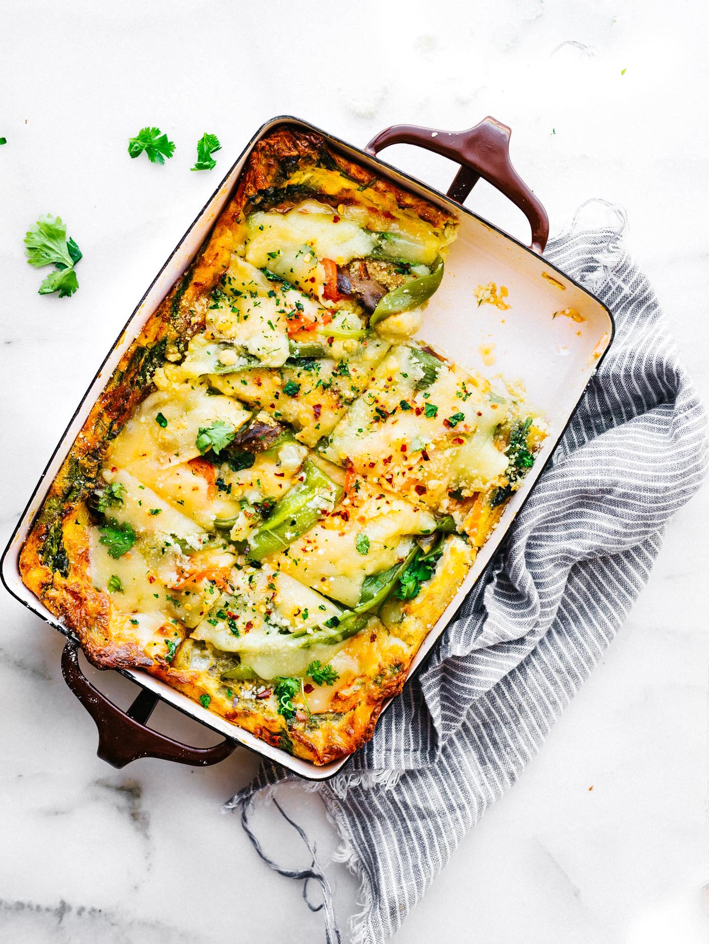 This Roasted Hatch Green Chile egg casserolemakes for a quick breakfast, lunch, or dinner! An egg casserole with layers of green chiles, artisan cheese, spinach, and other vegetables. It's wholesome yet light and delicious! Grain free, gluten free, and easy to make