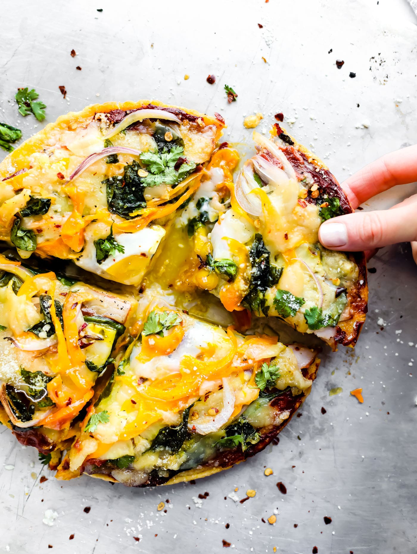 Abreakfast pizzarecipeyou can make for any meal! Socca pizza crust made from just 3 ingredients, sliced pineapple, uncured bacon, egg, onion, and creamy meltable artisan cheese! A breakfast pizza that's quick to make, grain free, and deliciously nutritious. You'll be hooked!
