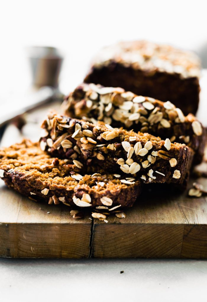 Pumpkin Oatmeal Bread is a simple, yet wholesome breakfast or homemade gift to give for holidays. You can't beat this delicious healthy combo; rolled oats, pure pumpkin, honey, cinnamon, and toasted nuts or dark chocolate chips to top. This pumpkin oatmeal bread is gluten free, dairy free, and ready in 45 minutes.