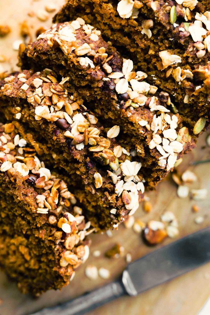 close up photo: homemade pumpkin oat flour bread, cut into slices