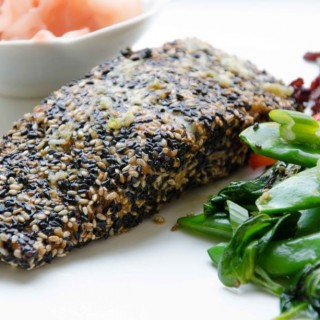 Asian Style Sesame Crusted Salmon with ginger garlic dressing. A refreshing ginger dressing compliments this Asian Style Salmon! Perfect as we transition into spring! Easy to make, full of omegas, and of course, gluten free!. Paleo friendly
