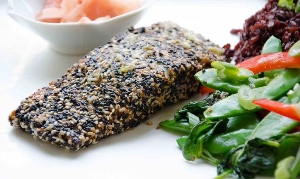 Sesame crusted salmon recipe with ginger garlic dressing. A refreshing ginger dressing compliments this Asian Style Salmon! Perfect as we transition into spring! Easy to make, full of omegas, and of course, gluten free!