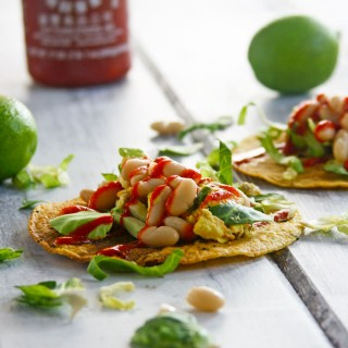 This gluten free tostadas recipe is made from sprouted grains, eggs, and white beans, and they're topped with a spicy chili sauce. It's a great vegetarian meal any time of day!