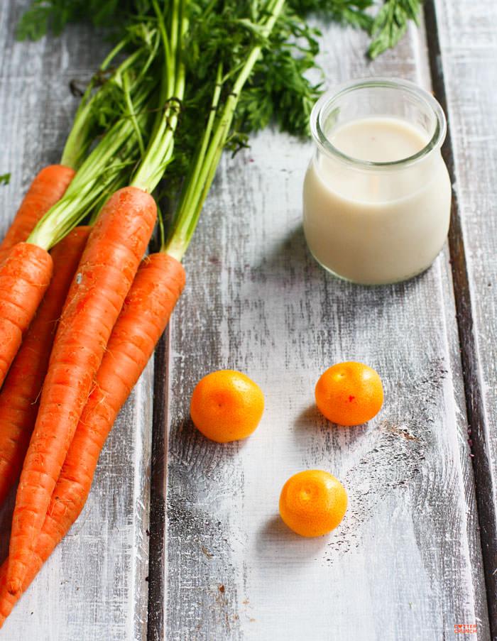 fresh carrots, oranges, and coconut milk