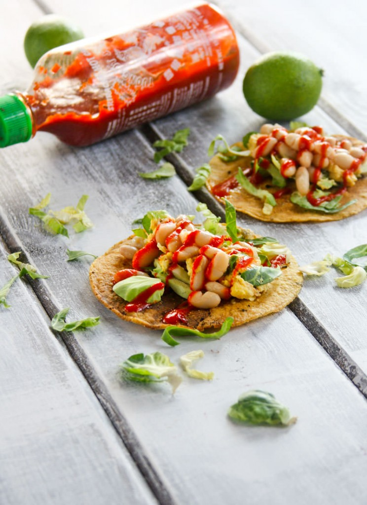 This Gluten Free Tostadas recipe is made with egg and white beans, and it's topped with a spicy chili sauce. It's a great vegetarian meal any time of day!