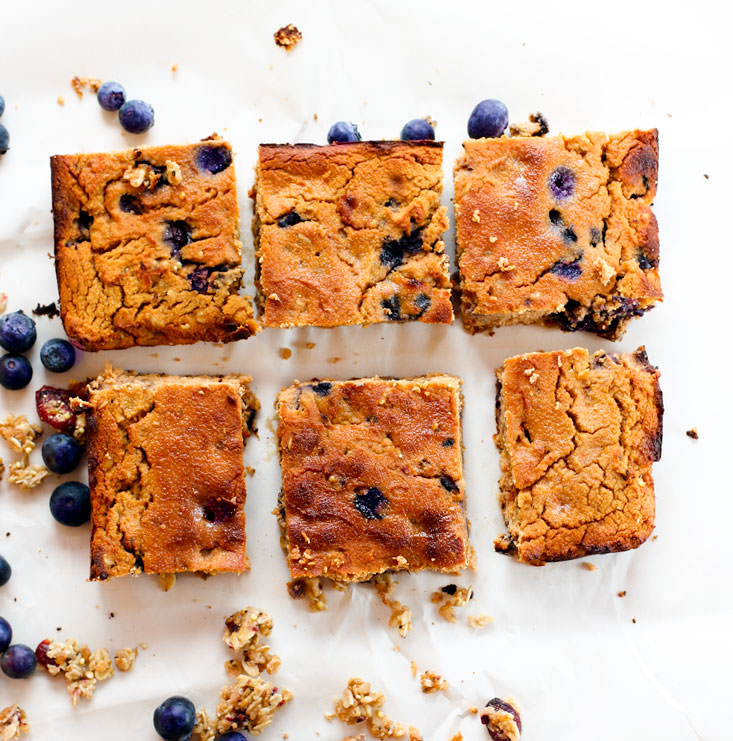 Blueberry Carrot Cake Breakfast Bars. When Summer and Fall baking collide, you get this! A mighty tasty breakfast bar with fresh blueberry, granola, and carrot spice! Made with gluten free ingredients, natural sugars, and a little extra protein.