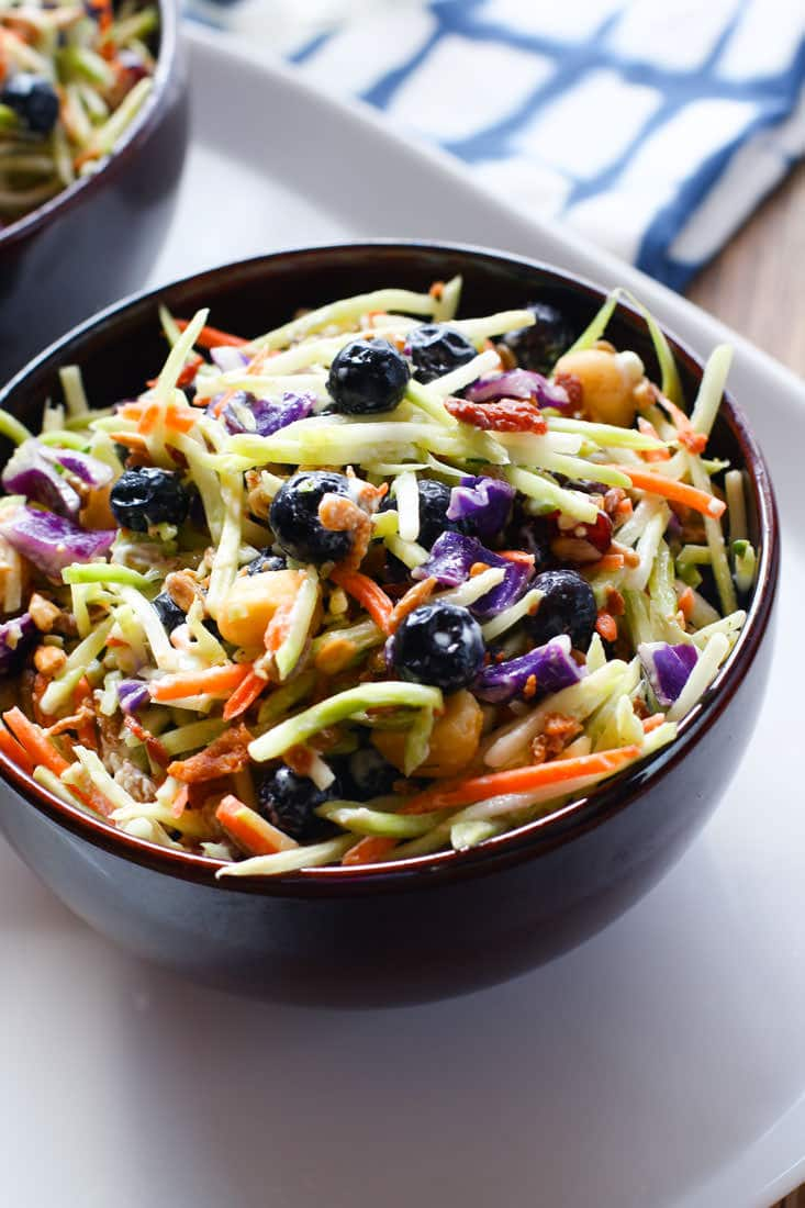 Perfectly Creamy and Tart Broccoli Slaw Salad with Blueberries. It's packed with antioxidants and probiotics! The tang comes from using a kefir and greek yogurt blend instead of mayo. Which also makes it healthy and gut friendly. Super clean eating with great flavor!
