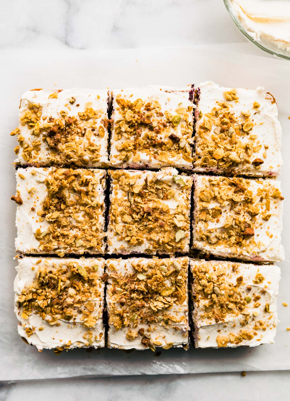 sliced carrot cake with granola topping