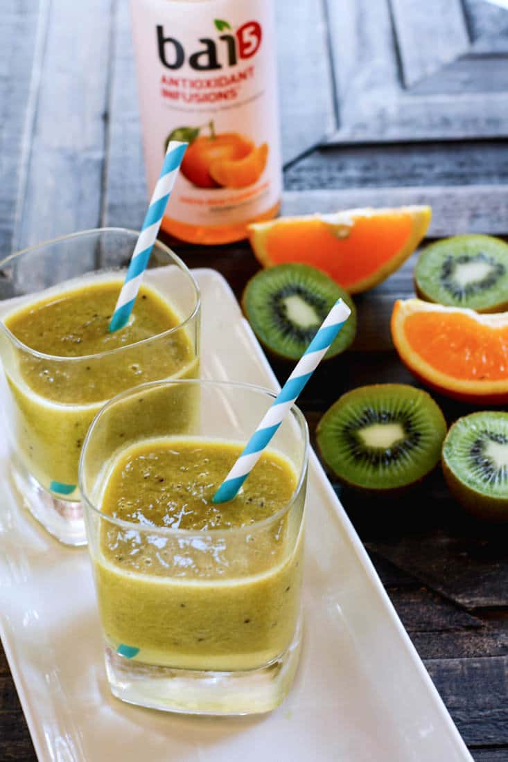 Homemade Orange Kiwi Citrus Electrolyte Slushy! Try this homemade citrus slushy drink to rehydrate and stay healthy during those hot summer months or with strenuous activity. A delicious drink packed with Vitamin C, Minerals, and Natural Sugars! This slushy combines the super powers over Orange, Kiwi, honey, Lime Juice, and sea salt to keep the body well tuned! Plus it's great for kids!