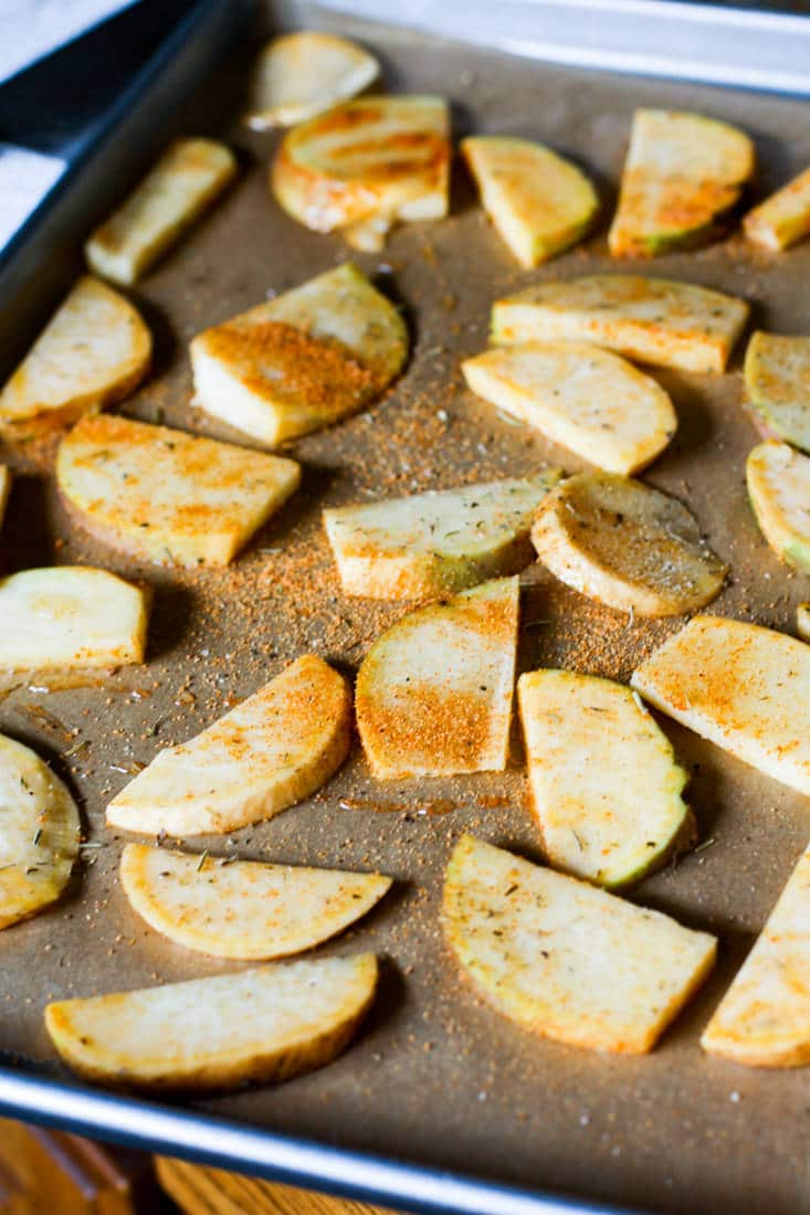 Gluten free BBQ Baked Rutabaga Chips! A healthy flavorful side dish for Summer BBQ's or any time of year! Rutabaga is a root vegetable that's easy to bake and cook with! These chips are super tasty, kid friendly, and naturally paleo/vegan! EAT UP!