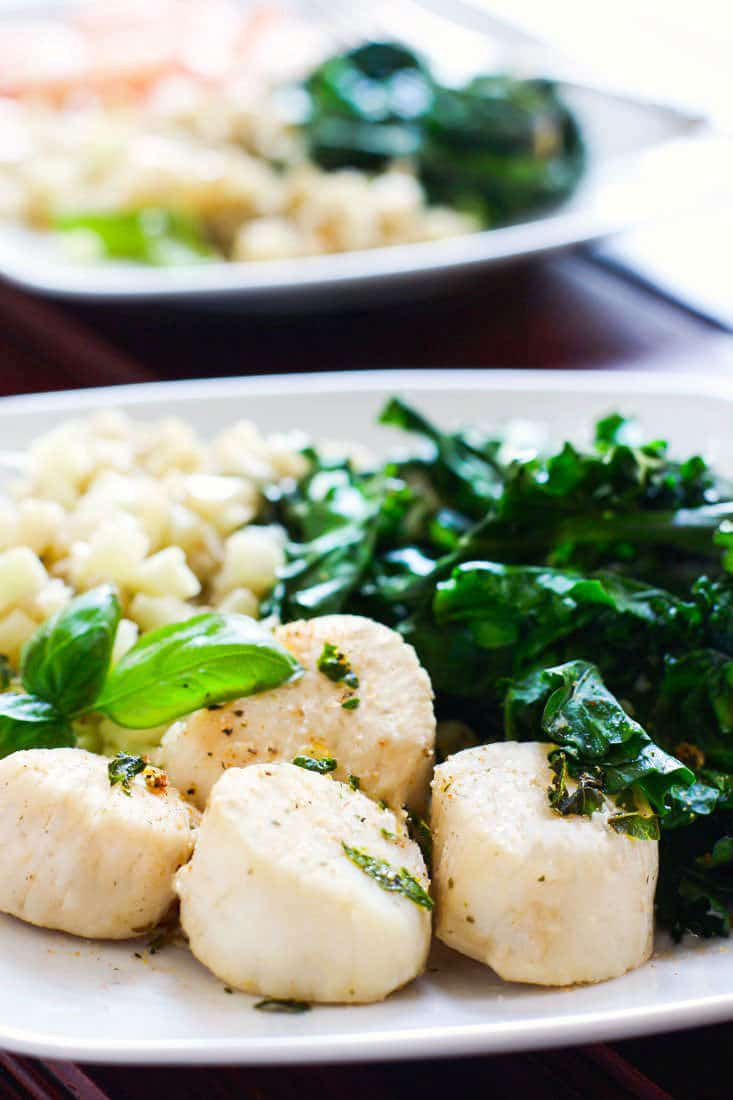 Steamed Scallops with Garlic, Herb, and veggies all cooked in ONE POT! Cooking Scallops can seem intimidating for some, but this paleo friendly dish is ready in 10 minutes and is SUPER easy to make. A Healthy Light meal for one or more!