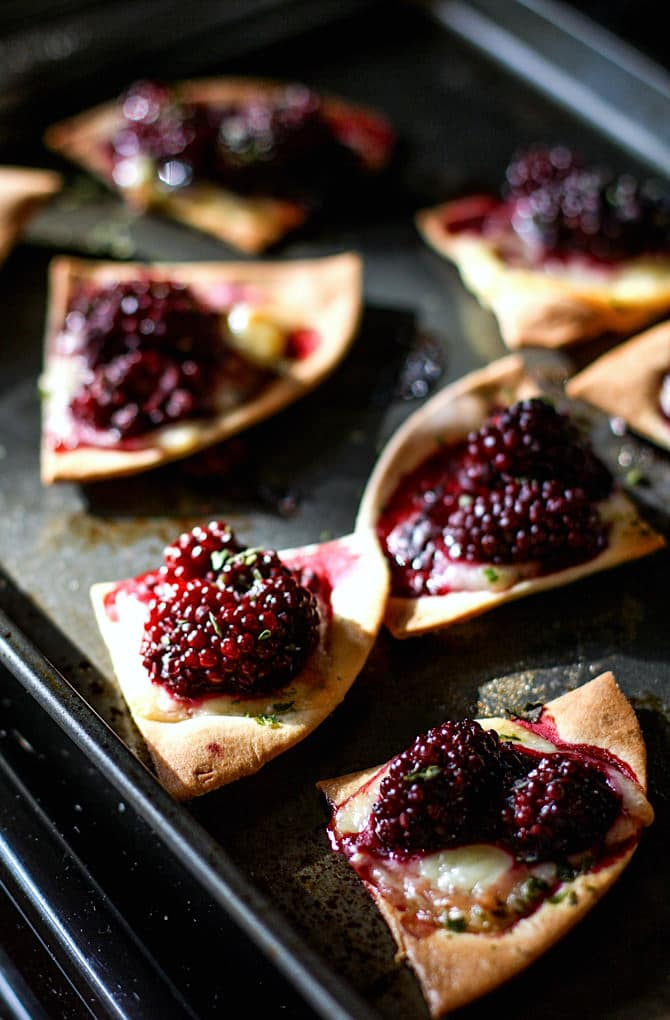 Gluten free Blackberry Basil Nachos. This vegetarian dish is amazingly delicious, protein packed, kid friendly, healthy, and ready in 20 minutes or less. Perfect for snacking, a post workout recovery snack or light meal, or even a fun appetizer!