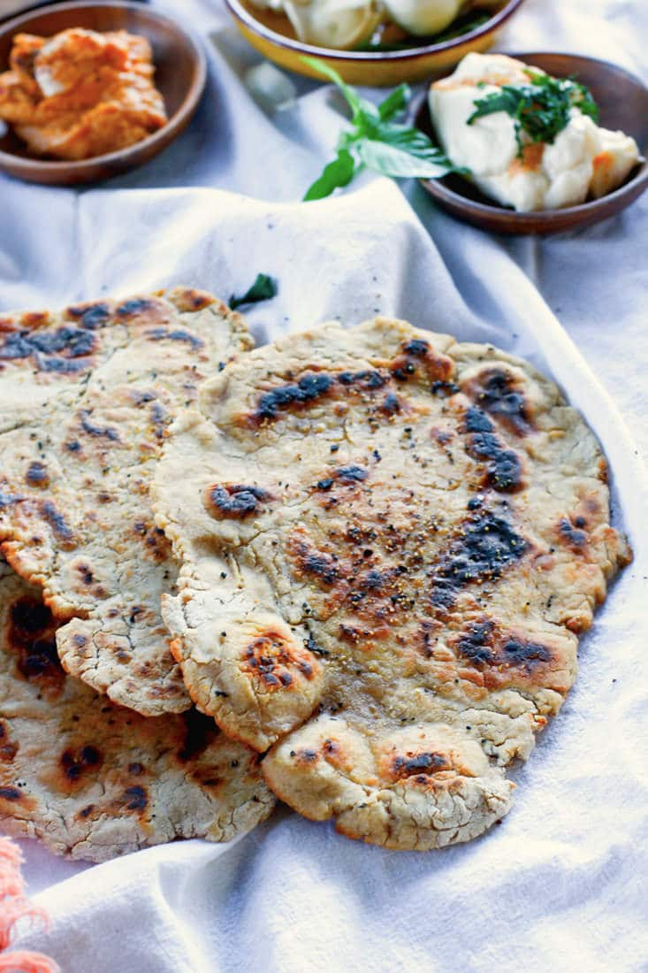 Grain Free Naan Bread with Cassava Flour! A simple and flavorful Middle Eastern bread made grain free and in 20 minutes or less! No oven required, just a skillet and few simple ingredients. Great with hummus, yogurt sauce, or by itself. Definitely a staple recipe you'll want to make over and over again!