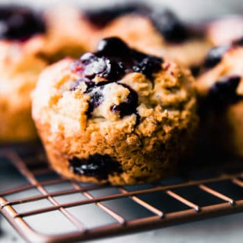 gluten free blueberry muffin sitting on wire cooling rack