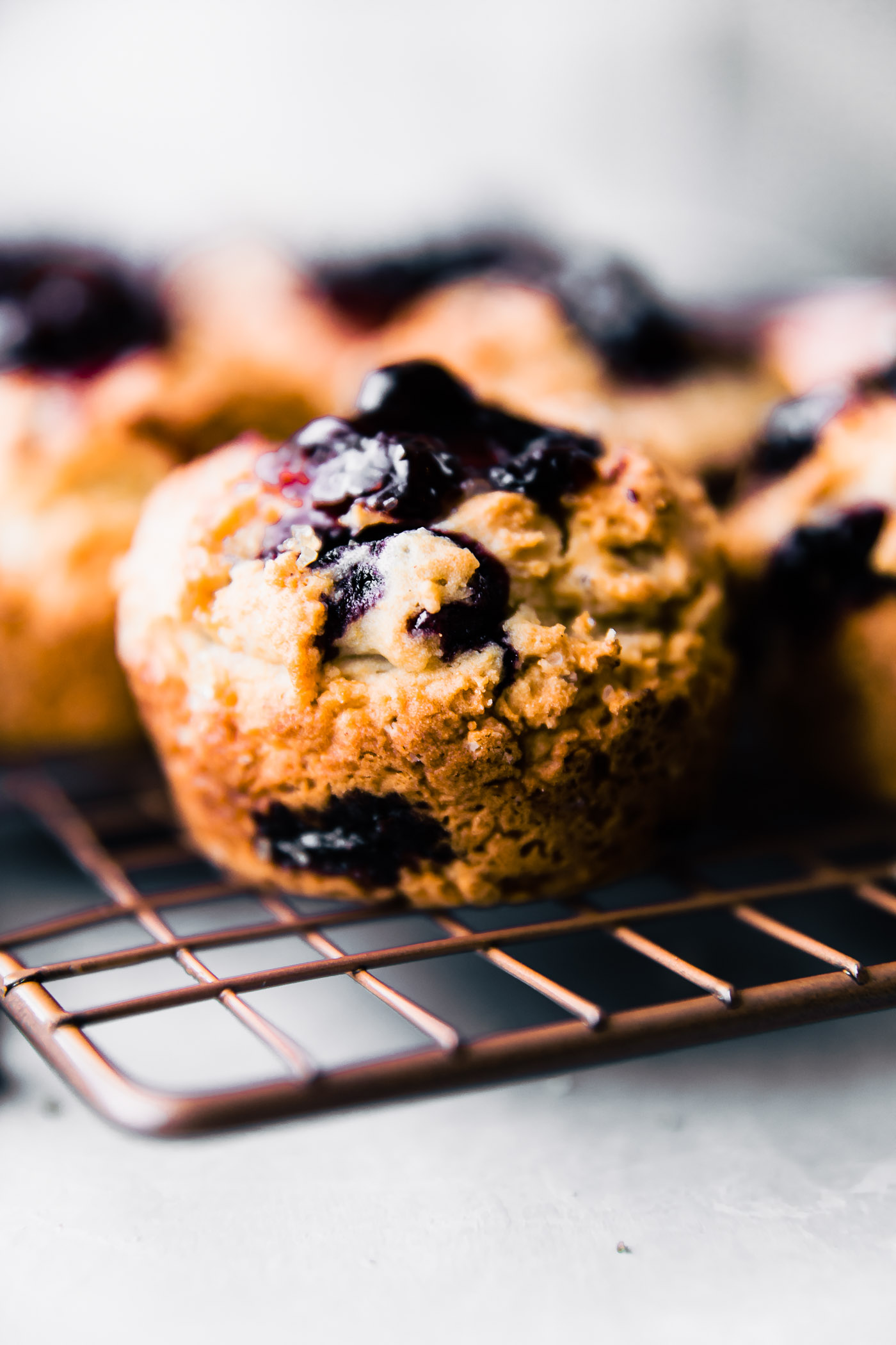 a low fodmap blueberry muffin sitting on a wire cooling rack