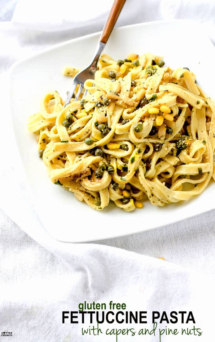 Healthy Fettuccine Pasta with Capers, Pine Nuts, and tossed in an herbed greek yogurt sauce!. This fettuccine recipe is light in flavor but also a bit creamy and comforting. A gluten free fettuccine pasta dish that's ready in 30 minutes and will nourish you and your whole family.