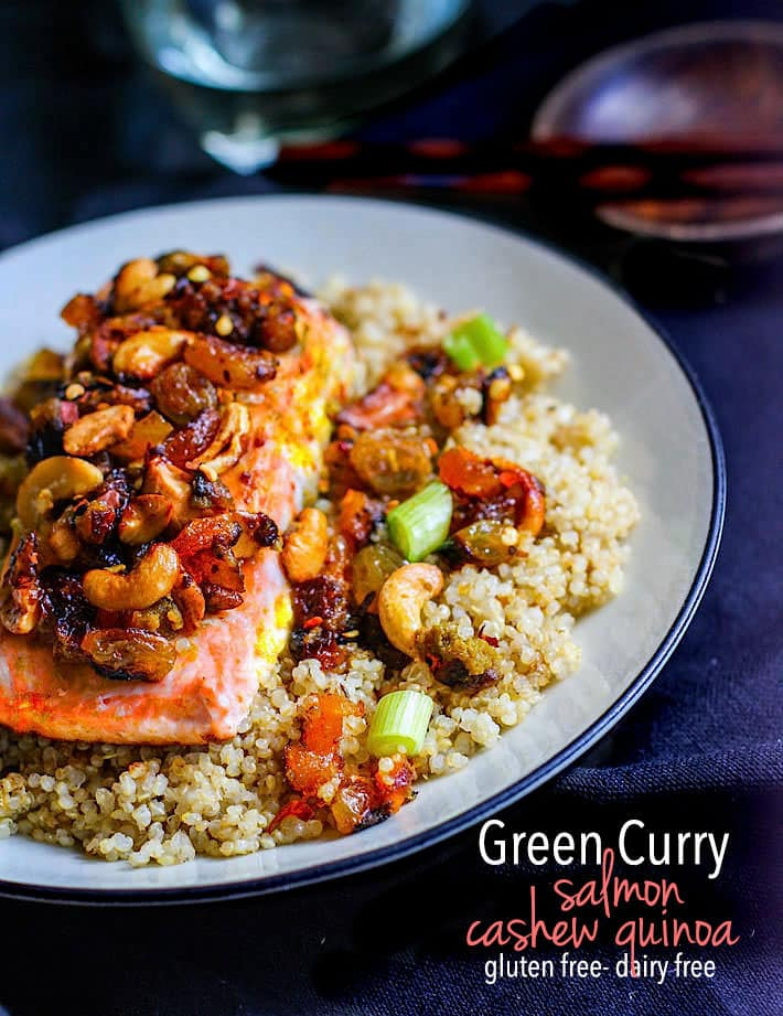 Green Curry Salmon and Cashew with Quinoa! Sweet and spicy green curry combined with cashews, salmon, and dried fruit! A healthy flavorful meal that is packed with anti-oxidants and comes together in 30 minutes! Great by itself or served on top of garlic quinoa!