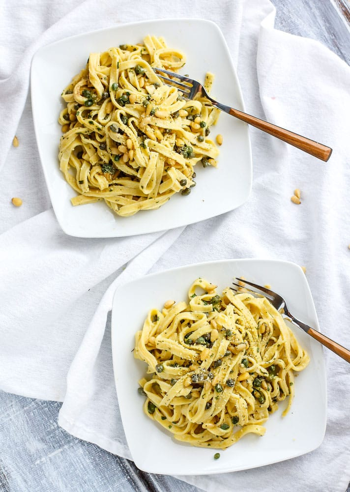 Healthy Fettuccine Pasta with Capers, Pine Nuts, and tossed in a tangy herbed yogurt sauce!. This fettuccine recipe is light in flavor but also a bit creamy and comforting. A gluten free fettuccine pasta dish that's ready in 30 minutes and will nourish you and your whole family. #glutenfree #grainfree options