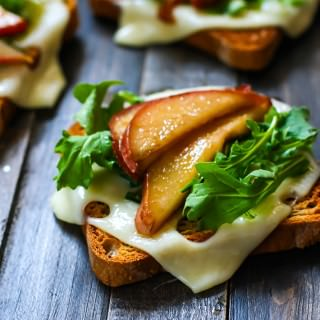 Honey balsamic-glazed pears with Swiss Cheese and arugula on Gluten Free Rye toast! A delicious vegetarian meal great for a quick lunch, appetizer, or even a post workout snack! Balanced with whole grain gluten free carbs, protein, and healthy fats!