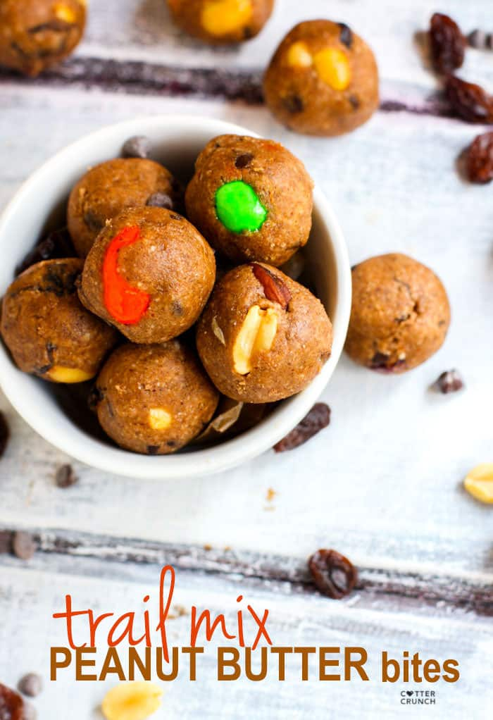 Gluten Free Trail Mix Peanut Butter Protein Bites! These no bake peanut butter bites are super easy to make, packed with protein, healthy fats, and great for snacking at any time! #cottercrunch