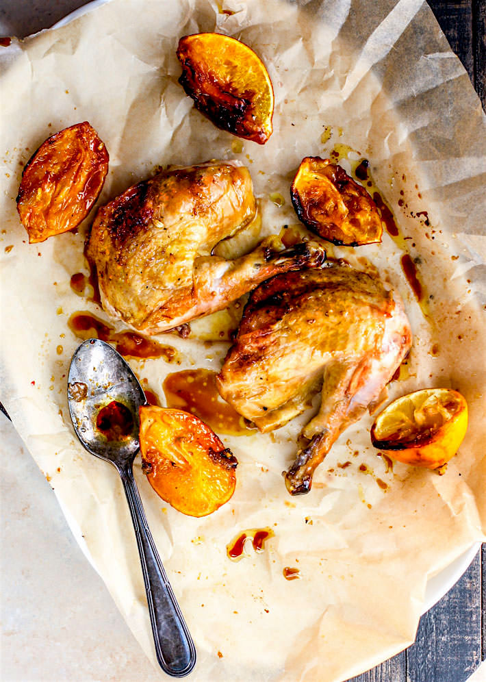 Gluten free One-pot Orange Honey Garlic Roasted Chicken. The sweet and savory orange sauces makes this roasted chicken so moist and flavorful. It's easy to make in the dutch oven and a total crowd pleaser for family or holidays! Paleo and dairy free!