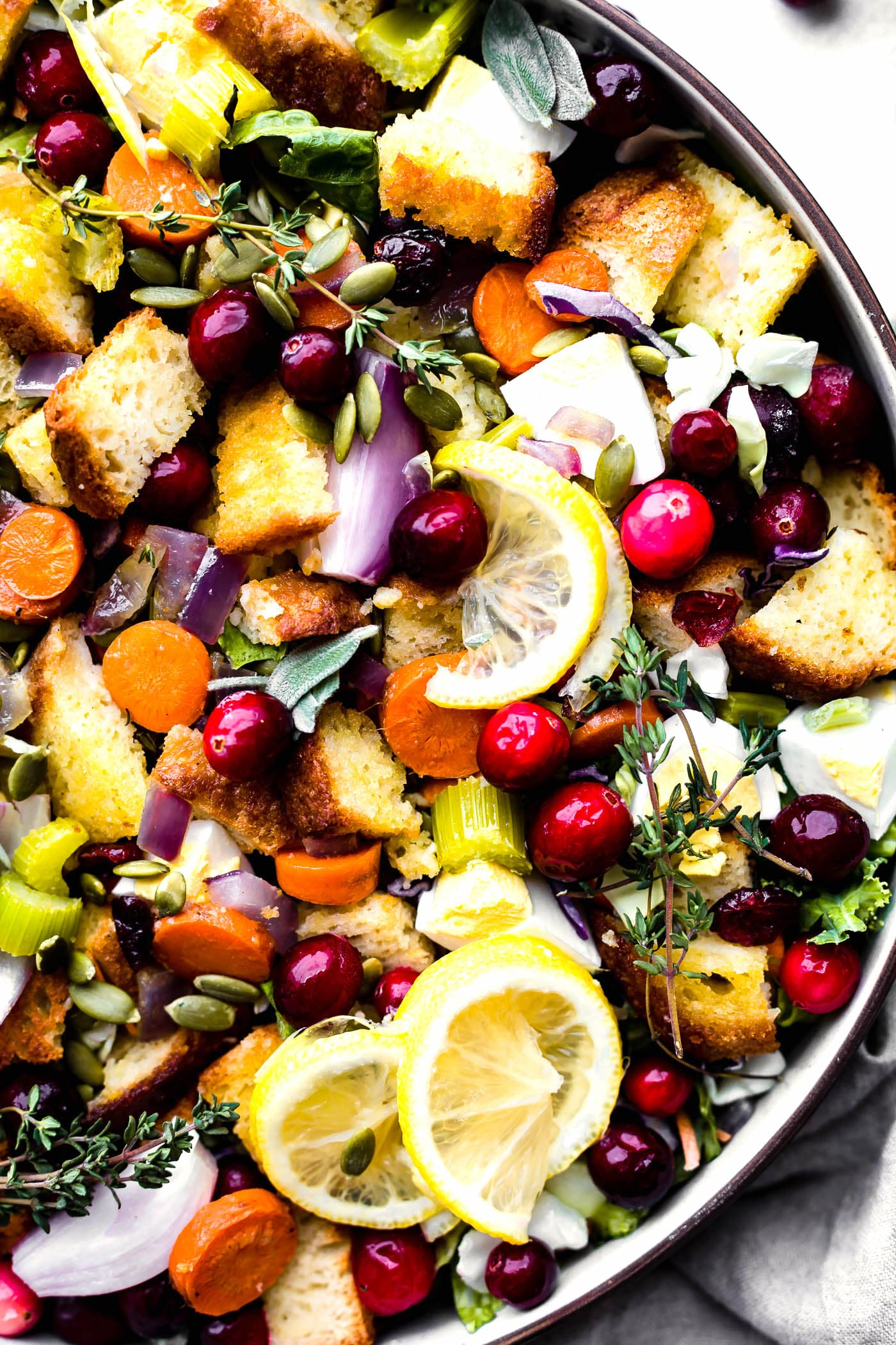 Gluten Free Stuffing Salad with Warm Onion Dressing! A lightened up Thanksgiving side dish that quick to make and flavorful. A Dairy free, easy, healthy gluten free stuffing recipe!