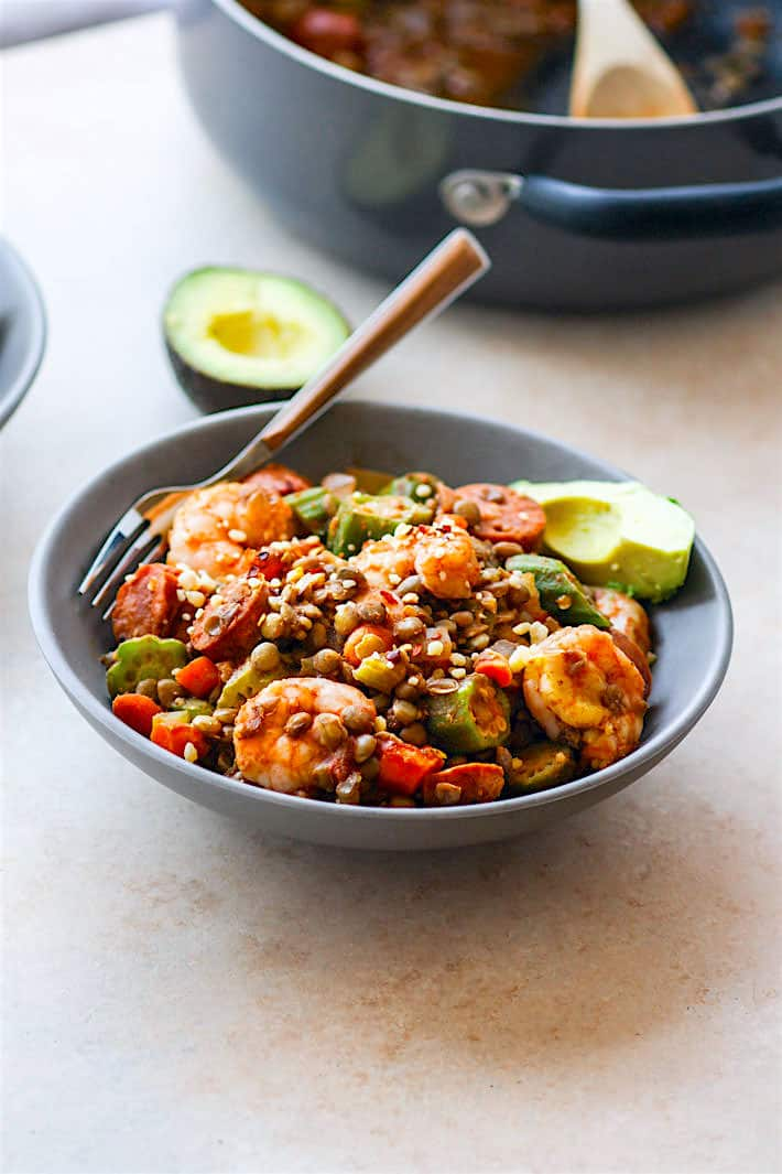 Southern food mash up! One Pot Shrimp Jambalaya Lentil Bowls! A grain free Healthy twist on classic Jambalaya and shrimp gumbo. Packed full of veggies, protein, and fiber! It's an easy one pot meal for a family, potlucks, or even to make ahead and freeze for later!
