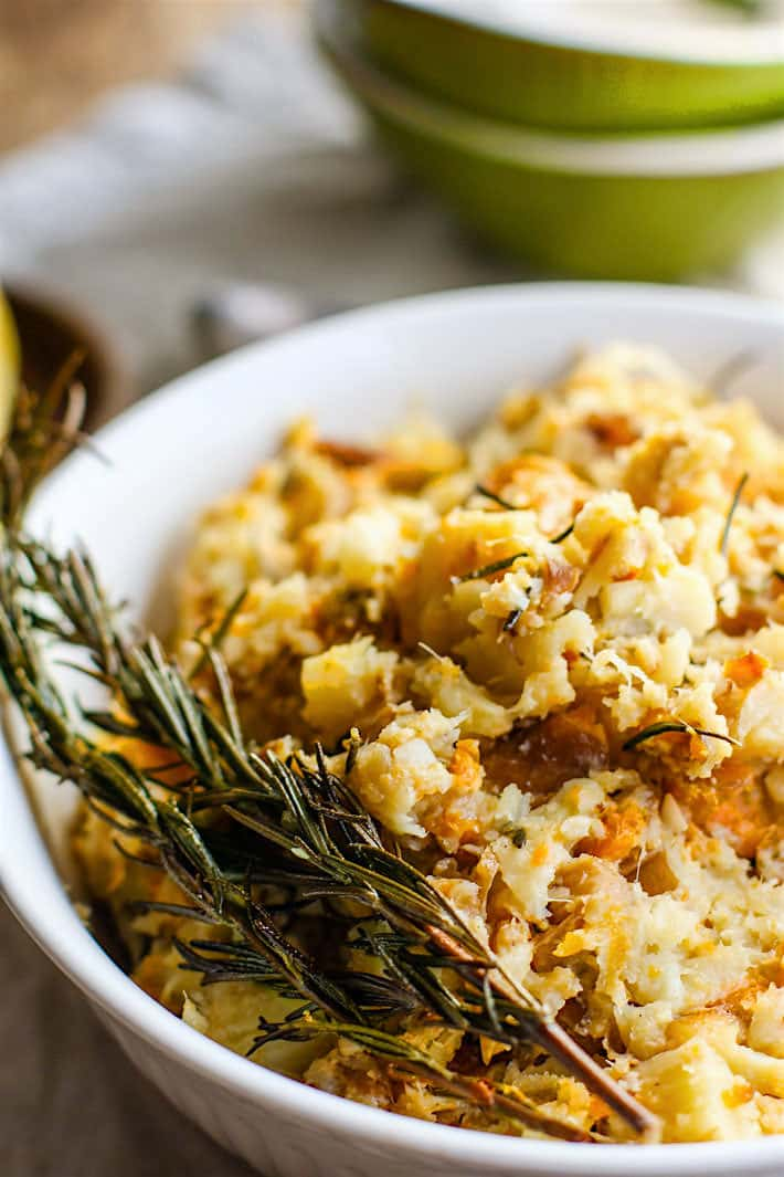 Crockpot Rosemary Carrot Parsnip Mash.  A healthy paleo gluten free side dish for your holiday table! Made simple and easy in the crock pot with real ingredients you have in your pantry! No stress and no mess. Vegan friendly.