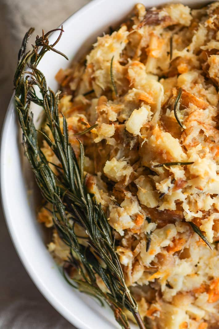 Crock Pot Rosemary Carrot Parsnip Mash. A healthy paleo gluten free side dish for your holiday table! Made simple and easy in the crock pot with real ingredients you have in your pantry! No stress and no mess. Vegan friendly.